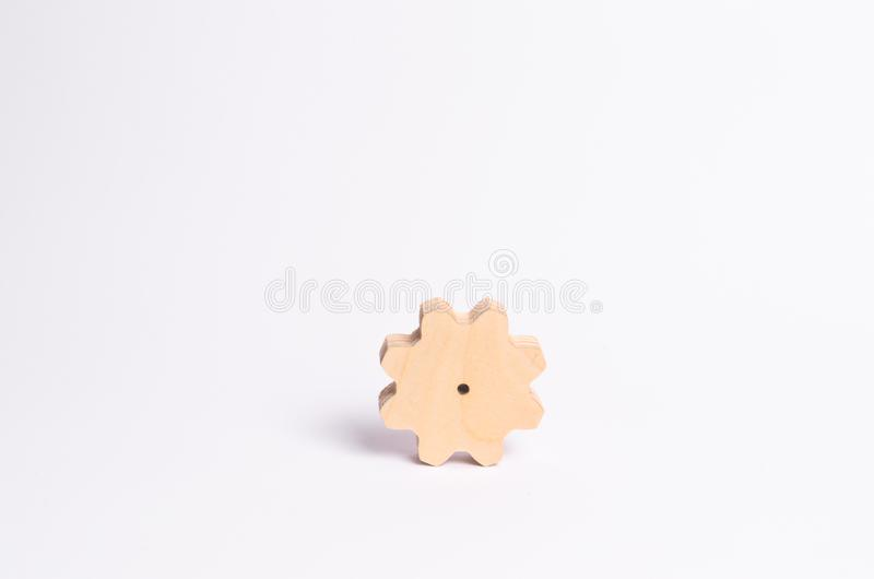 Wooden gear on a white background. Abstract background for presentations and banners. The concept of technology and industry. The think process. Part of a royalty free stock photography