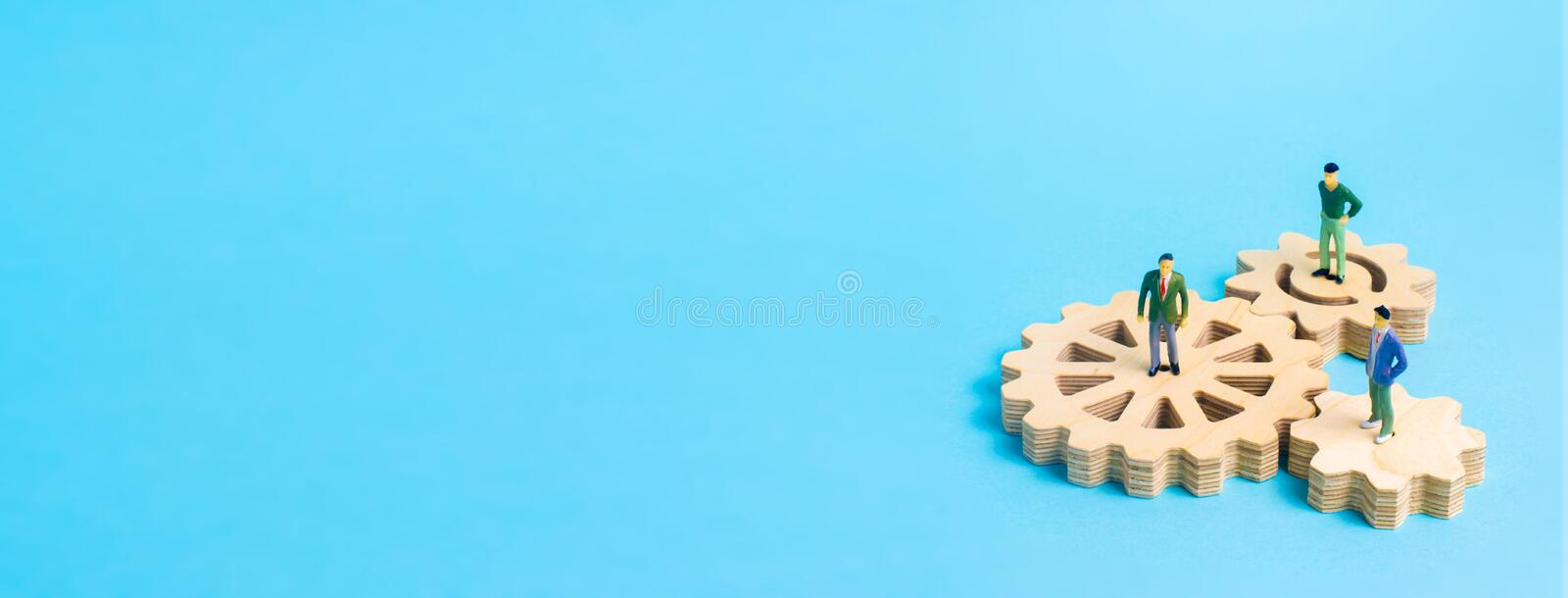 Wooden gear on a white background. Abstract background for presentations and banners. The concept of technology and industry. The think process. Part of a royalty free stock photos