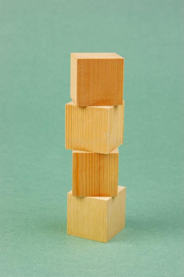 Wooden geometric cube stock image