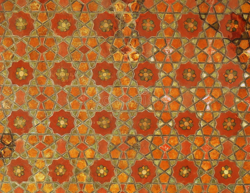 Wooden geometric mosaics carved on Isfahan palace ceiling. Wooden mosaics carved on the ceiling of the Ali Qappu palace of Isfahan stock image