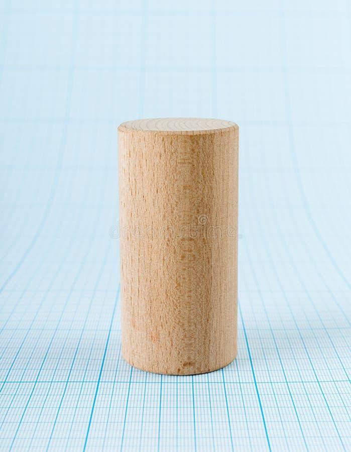 Wooden geometric shape cylinder stock image