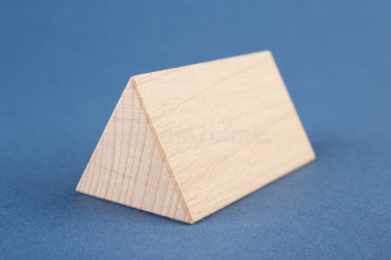 Wooden geometric shapes on a blue. Background stock image
