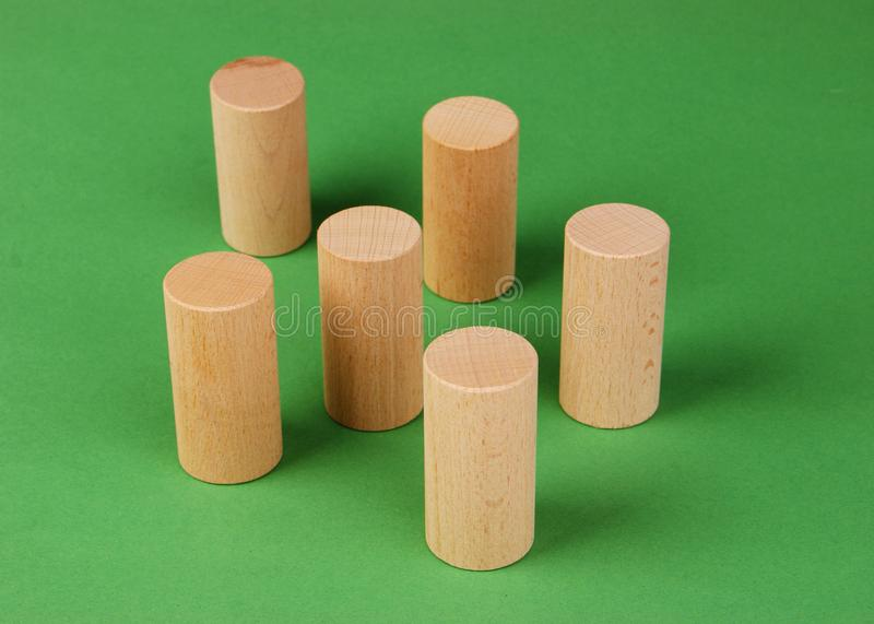 Wooden geometric shapes. On a green background stock images