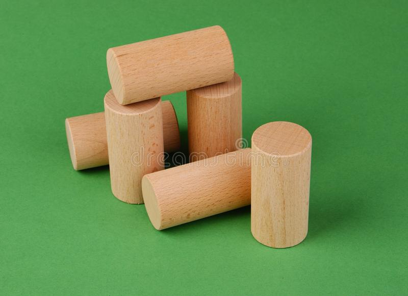 Wooden geometric shapes. On a green background stock photos