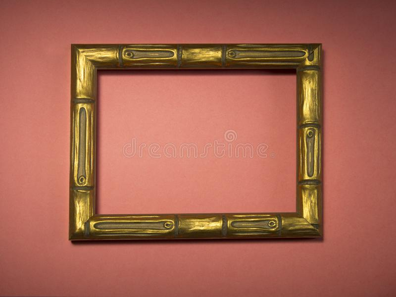 Wooden gilded frame without a photo or picture on a background royalty free stock image