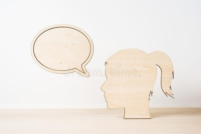 Wooden girl silhouette head with dialogue frame stock photos