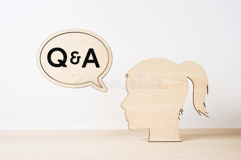 wooden girl silhouette head with word Q royalty free stock images