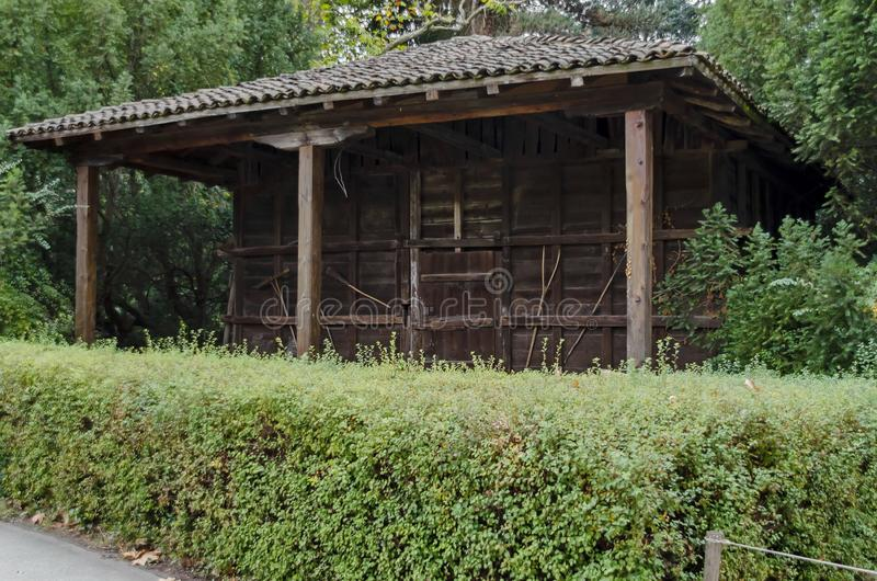 Wooden granary in National monument of landscape architecture Park in former time royal residence on the outskirts of Sofia. Bulgaria, Europe stock image