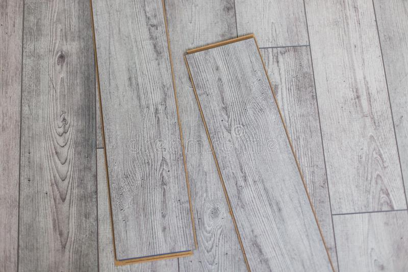 Wooden gray panels on new laminated flooring before install. Wooden gray panels on new laminated flooring stock images