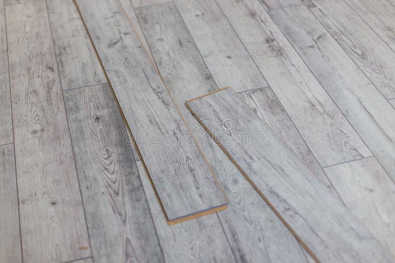 Wooden gray panels on new laminated flooring before install. Wooden gray panels on new laminated flooring stock photography