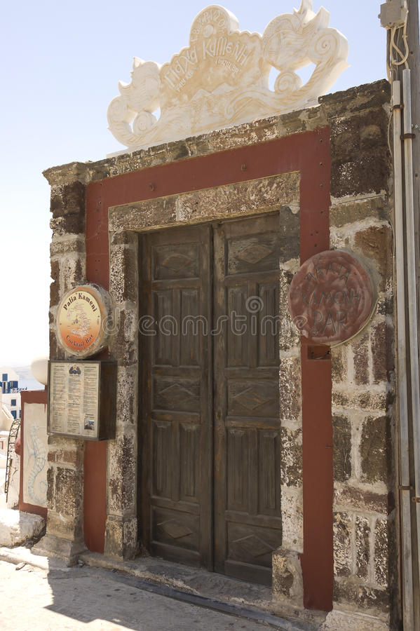 Wooden and grungy restaurant door royalty free stock images
