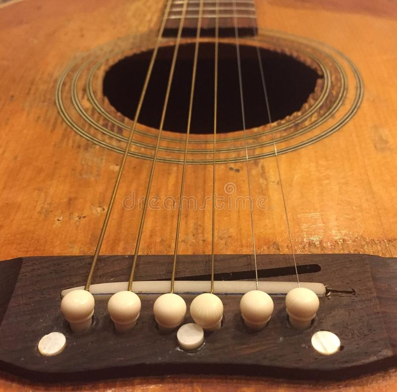 A wooden guitar. An up close photo of a wooden guitar royalty free stock image
