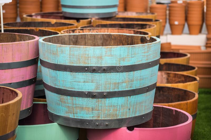 Wooden half barrel for plants and gardening. For sale at gardens store stock image