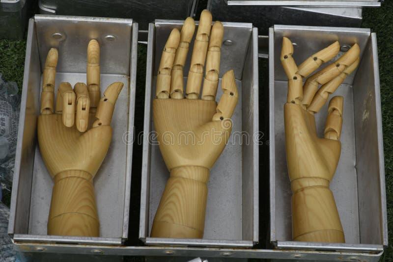 Wooden hand artist show flexible thumb. Palm hand wooden finger thumb flexible model art show action stock photo