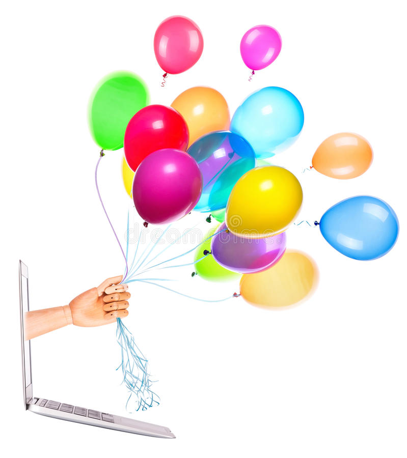 Wooden Hand With Balloons And Laptop Stock Photo