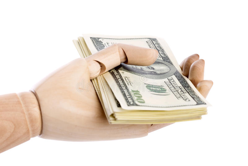 A wooden hand with dollars