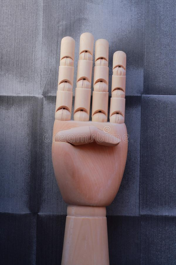 Wooden hand with four raised fingers royalty free stock photos