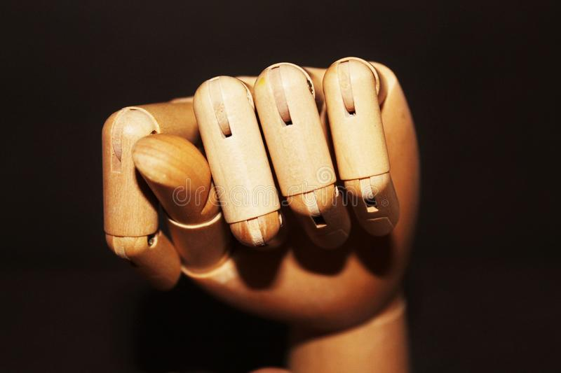 Wooden hand shows the fig gesture royalty free stock image