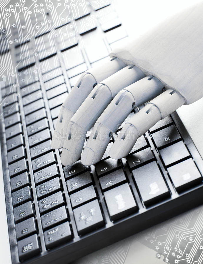 A wooden hand is typing stock photo