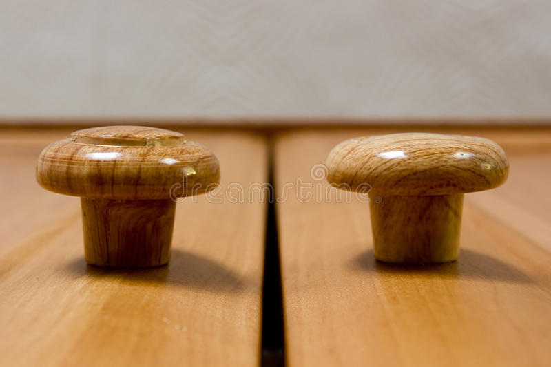 Wooden handles cabinets royalty free stock images