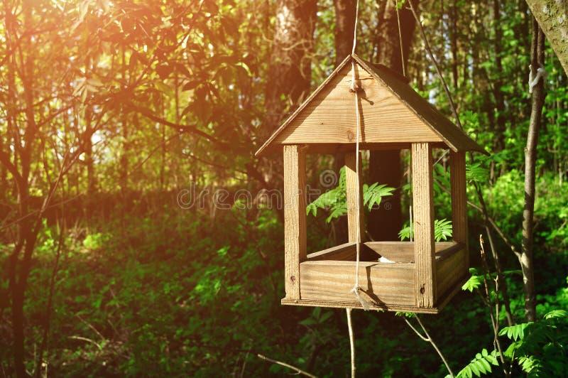 Wooden handmade bird feeder in form of little house stock photography