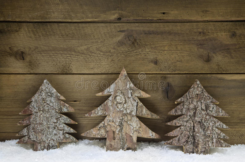 Wooden handmade christmas trees - natural congratulatory card. royalty free stock photos