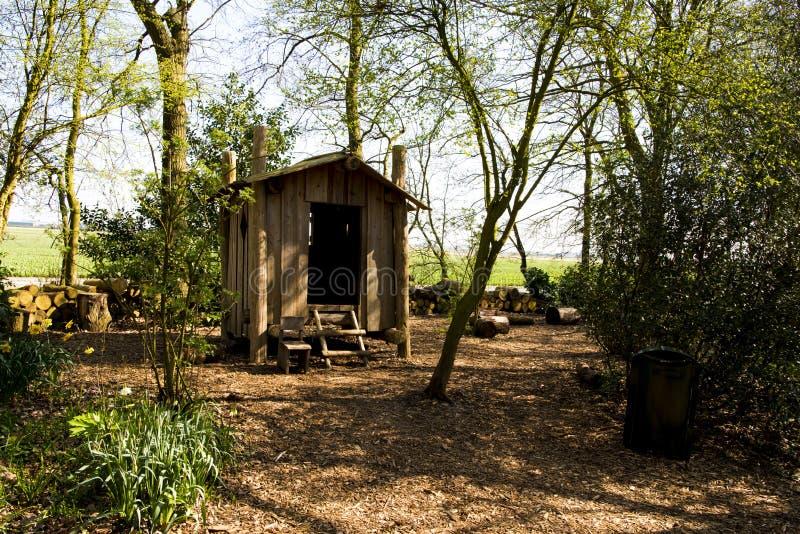 Log cabin in Garden with handmade ladder in spring garden royalty free stock photography