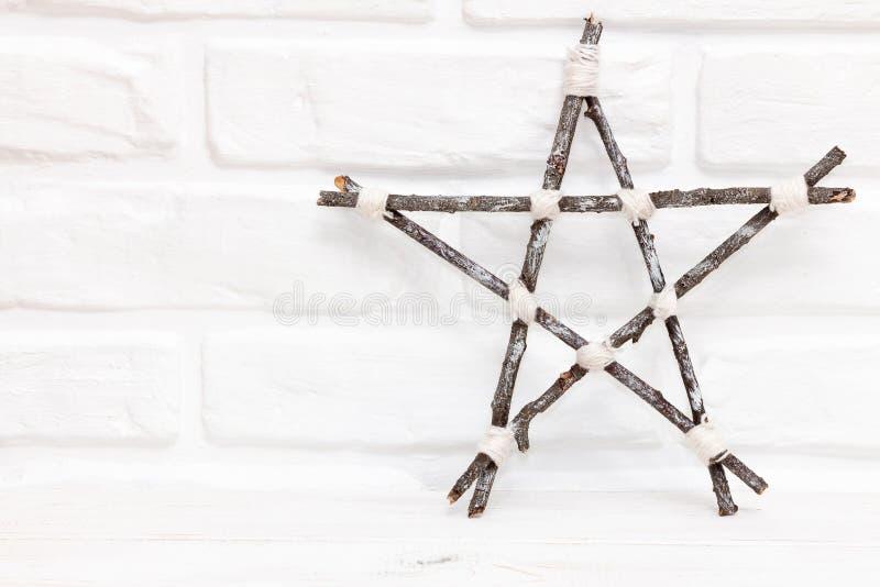 Wooden handmade star on white background stock images