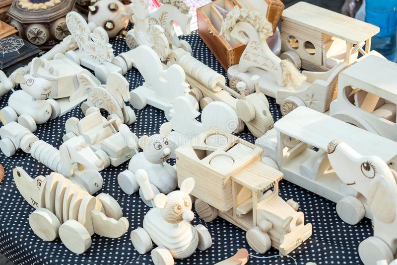 Wooden Handmade Toys. Cute souvenir decorative toys, dolls, animals, machines and sorters. Handmade souvenir Wooden crafts. At the market, traditional craft stock images