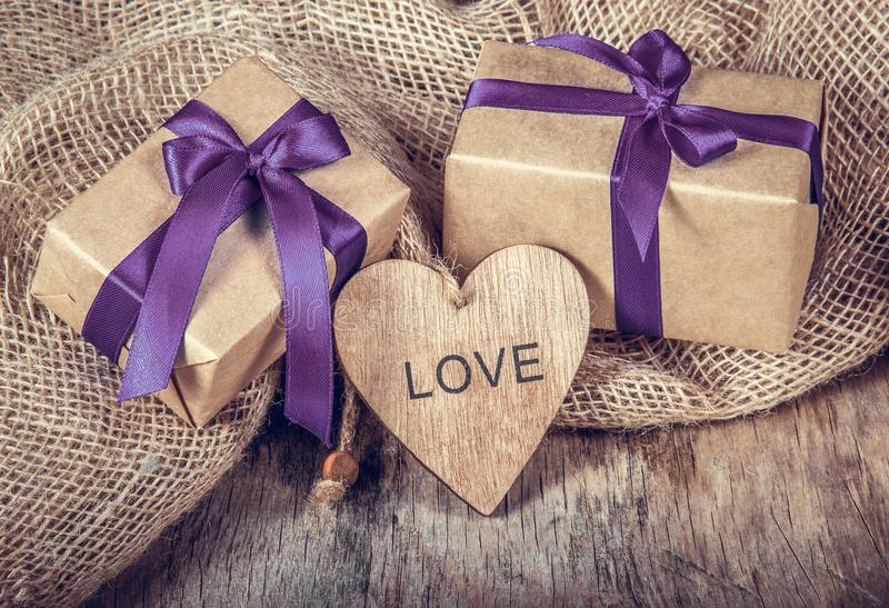 Wooden heart and gift box with ribbon. Romantic decoration for Valentine`s Day. Symbol of love. stock images