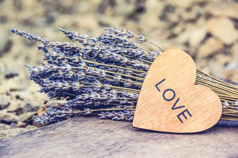 Wooden heart and lavender. Romantic concept. Valentine card. stock image