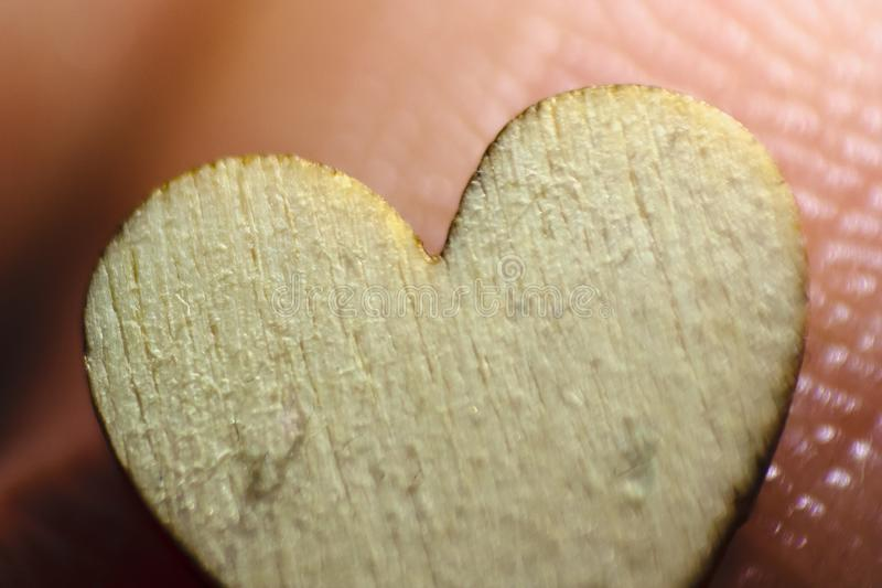 Wooden heart magnified. Macro symbol of love. Valentine`s day background. For lovers stock photos