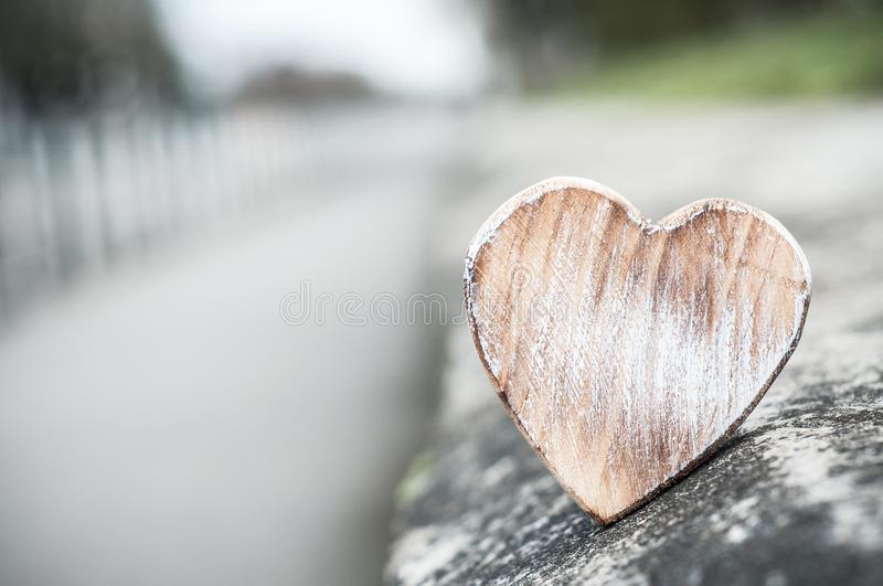 wooden heart in outdoor with perspective - Love conce stock photo