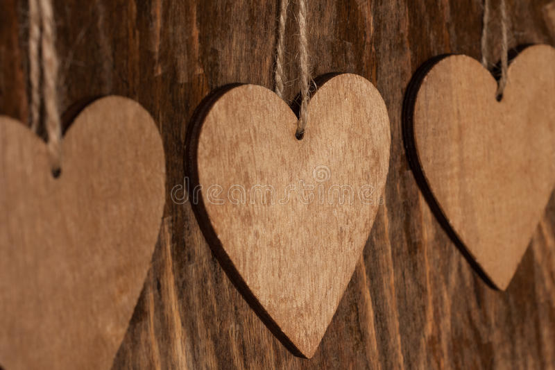 Wooden Heart With Rope On Wooden Background. Wooden Brown Heart With Rope On Wooden Background Close Up royalty free stock photos