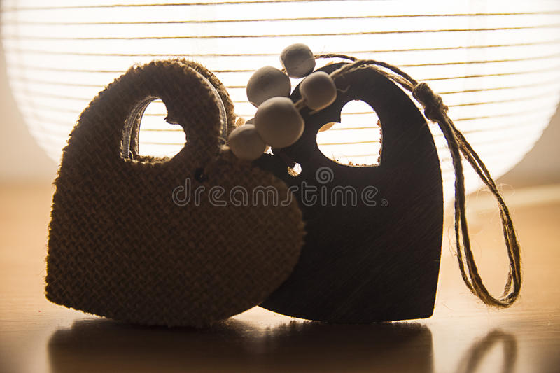 Wooden hearts with backlight royalty free stock image