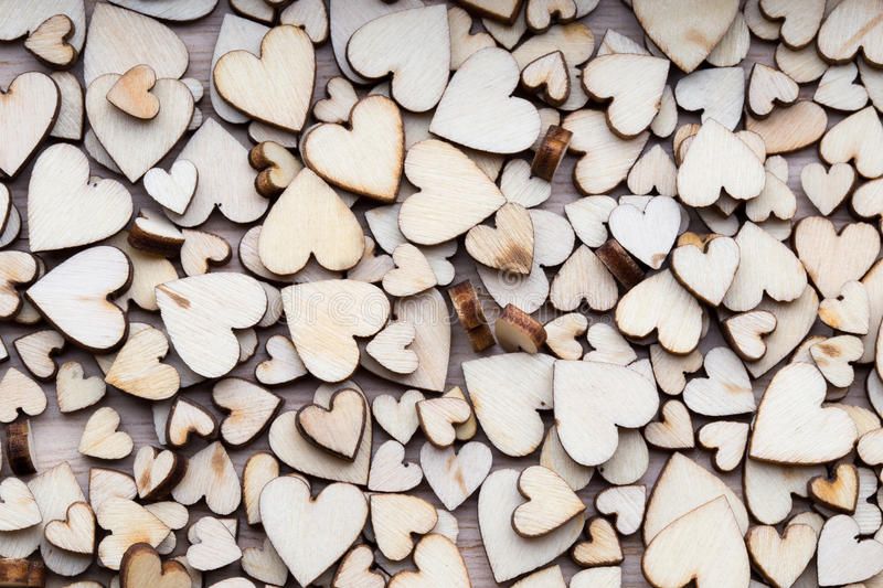 Wooden hearts, one red heart on the heart background. Wooden hearts, one red heart on the heart background stock photography
