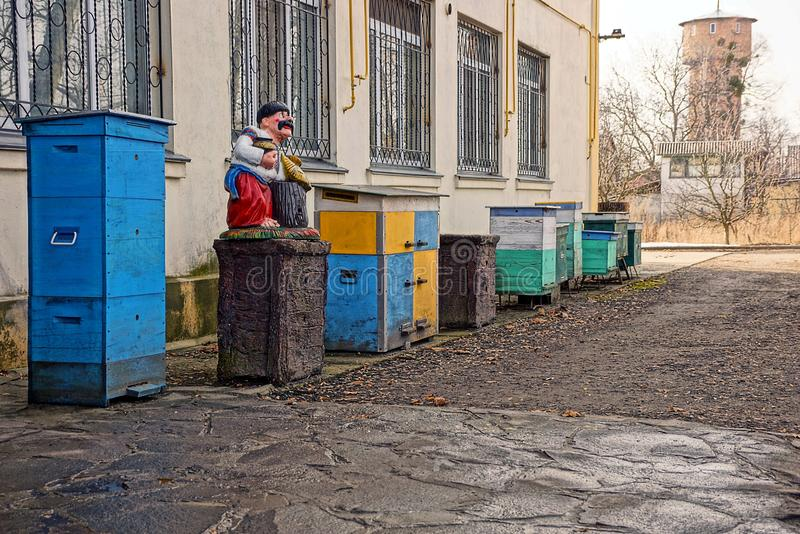 Wooden hives in the yard along the wall of the building royalty free stock photos