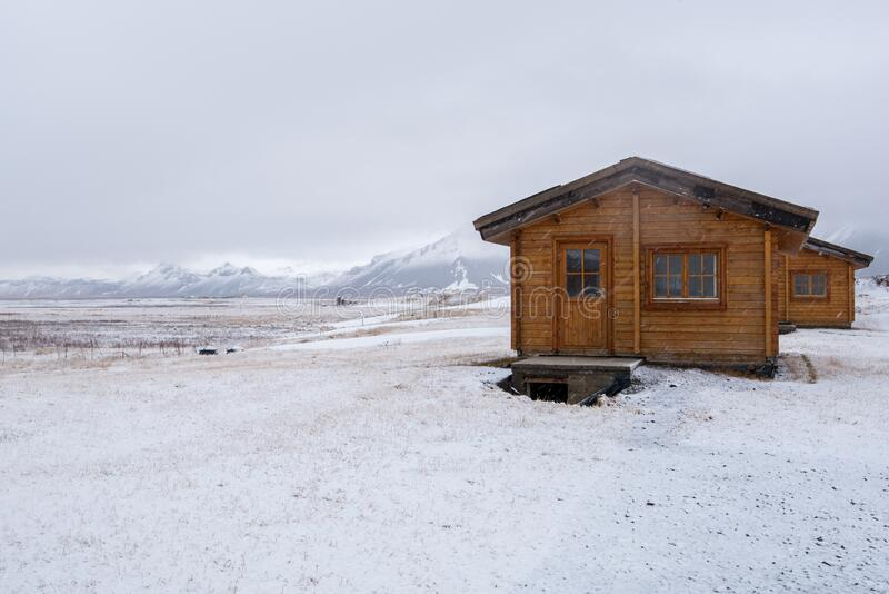 Wooden holiday chalets at the countryside in winter in Iceland royalty free stock images