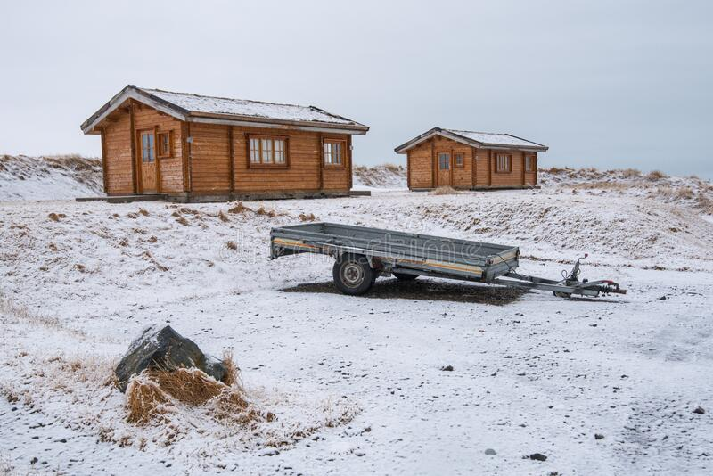 Wooden holiday chalets at the countryside in winter in Iceland stock photo
