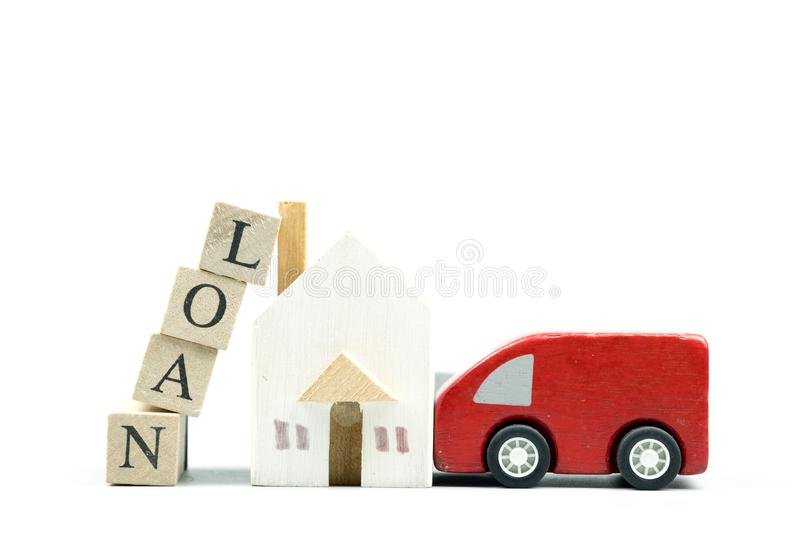 Wooden home and car model with wooden blocks with words of loan stock photos