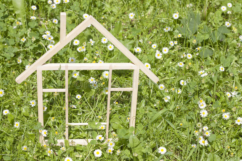 Wooden home in spring green grass stock photo