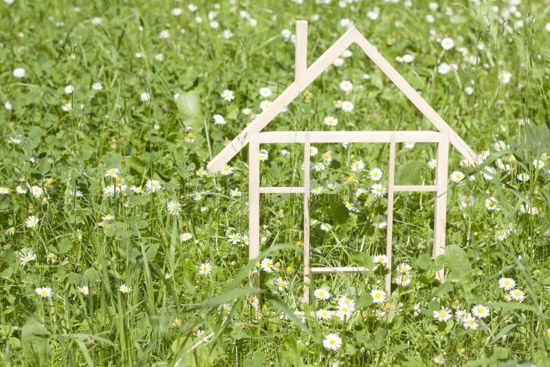 Wooden home in spring green grass stock photos