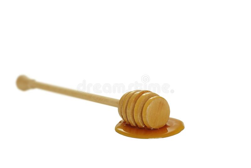 Wooden honey drizzler. On white background stock photography