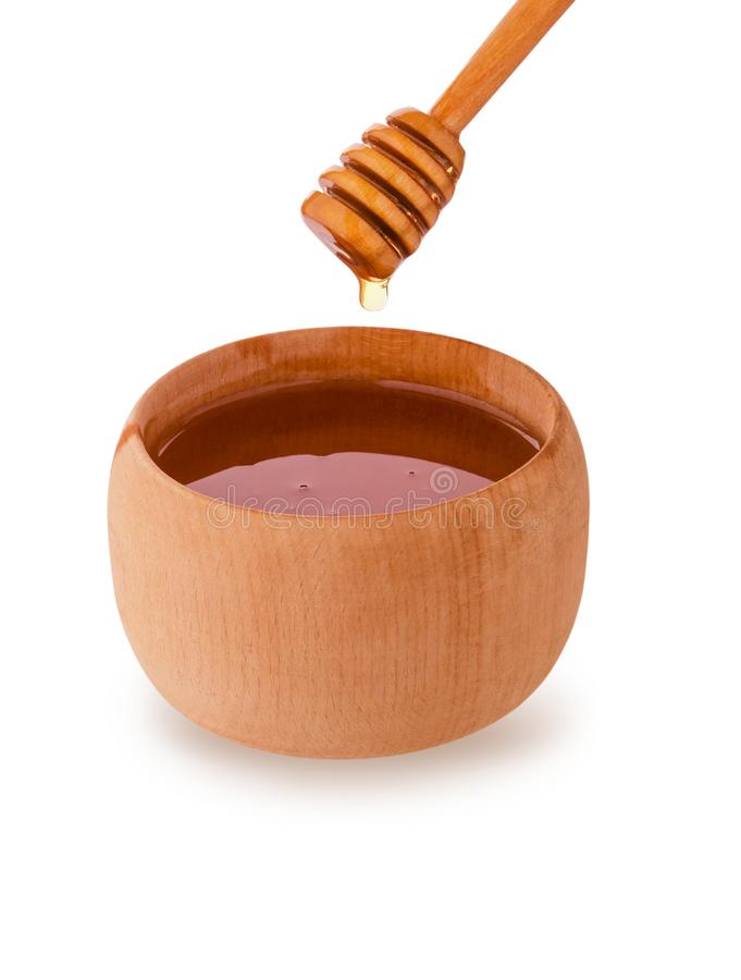 Wooden honey pot and stick dripping with honey bee isolated on white background with clipping path. Design element package royalty free stock images