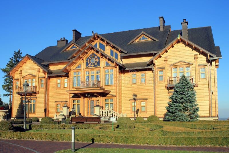 Wooden Honka house in Mezhyhirya, Kyiv region, Ukraine. stock images