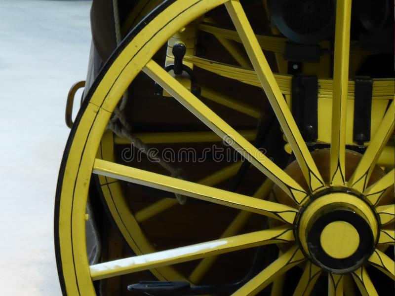 Wooden horse cart wheel, yellow wheels. royalty free stock image