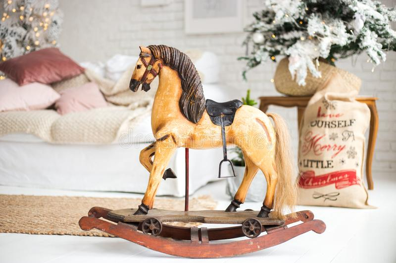 A wooden horse for Christmas. a gift for children. New Year`s Little Horse stock image