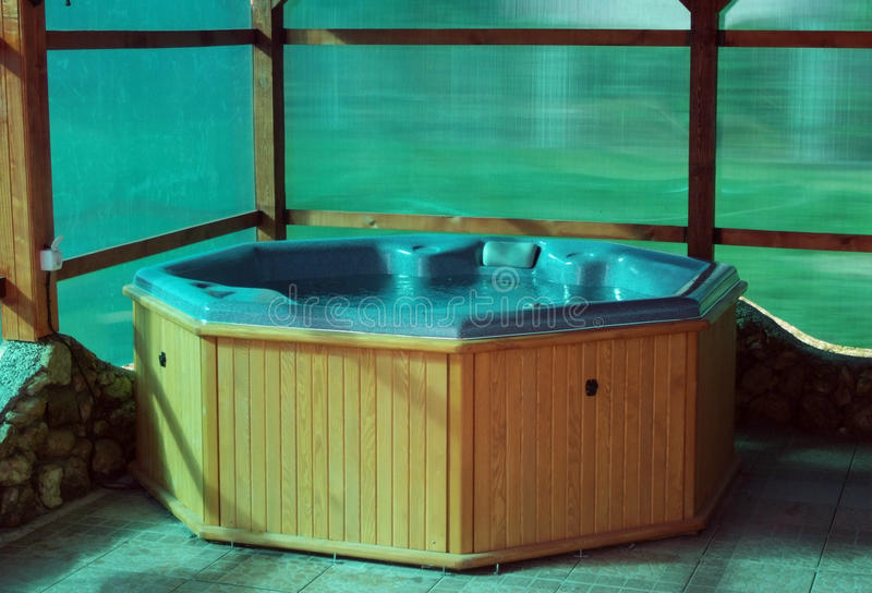 Wooden hot tub stock images