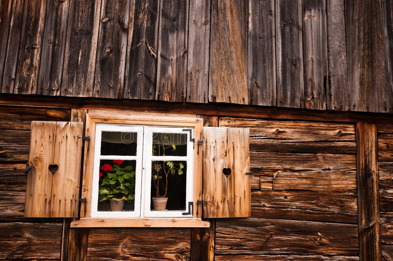Wooden house. Window with shutter of wooden house stock image