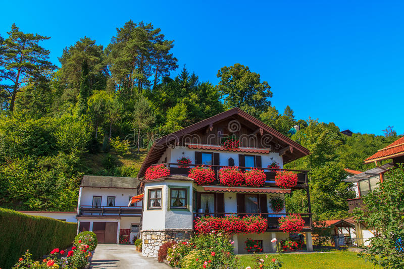 Wooden house in the Alpine mountains, Austria stock photography